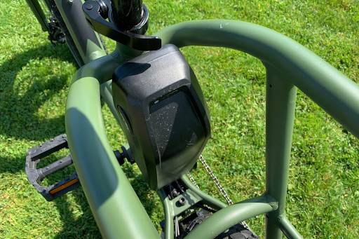 The frame of the green e-bike with the battery