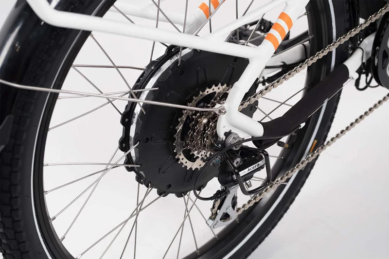The back wheel of the white bike