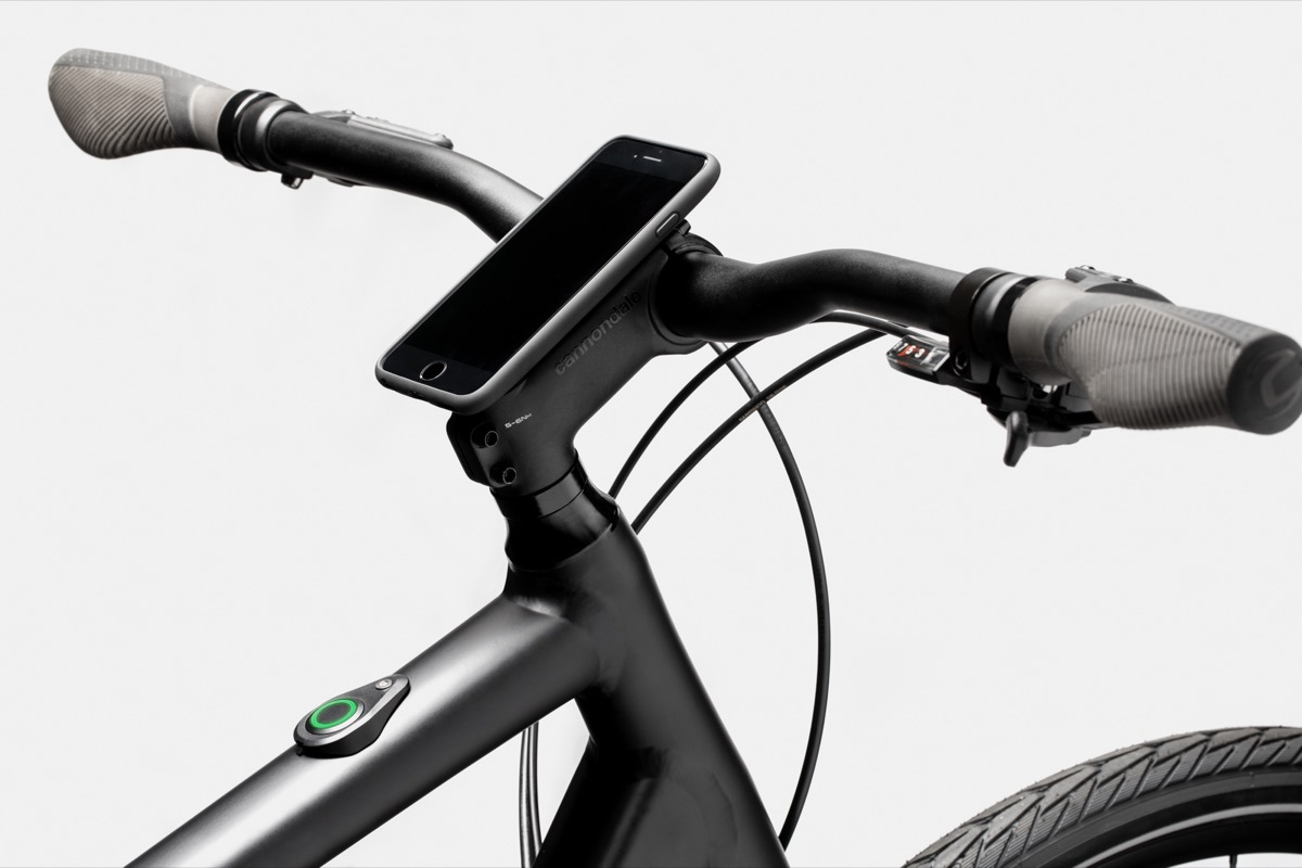 Handlebar of a bicycle with a phone on it